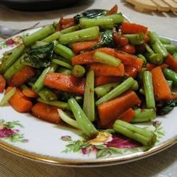 Bok Choy, Carrots and Green Beans Recipe - We love stir fry. It 's so orderly. First come the shallots, then the carrots and then the beans. Then the bok choy, the veggie broth and the soy sauce. That 's it. Delicious.