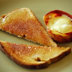 Individual Baked Eggs Recipe - A very easy idea with a minimum of fuss or muss for any number of people.  Individual Baked Eggs surrounded by a strip of bacon, and topped with a square of cheese. These eggs take on a very pleasing flavor just by baking instead of cooking them in the more conventional manner. Great not having splatters all over, and being able to do 12 or more eggs at one time.