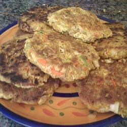 Patty's Tofu Burgers Recipe - Tofu and rolled oats form the base of these easy-to-make vegetarian burger patties.