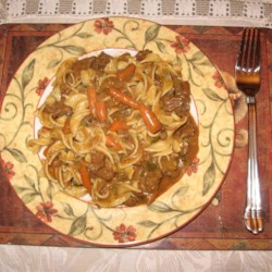 Hearty Beef Dinner Recipe - Beef stew meat is slowly cooked with onions, garlic and mushrooms, then topped off with sour cream. It's like a cross between stew and stroganoff.