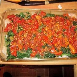 Baked Haddock with Spinach and Tomatoes Recipe - This delicious baked haddock is prepared with spinach and diced tomatoes, then smothered in a rich, tangy tomato sauce.