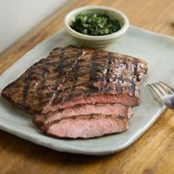 Flank Steak Marinade Recipe - Light brown sugar and honey are blended with soy sauce, garlic, and green onion to make a savory sweet marinade for flank steak.