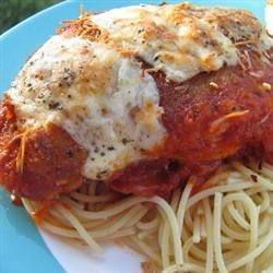 Tomato Chicken Parmesan Recipe - A double cheese effect, as Parmesan-coated chicken swims in a pool of pasta sauce with a blanket of melted Monterey Jack over all.