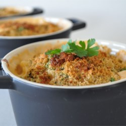 Home Style Macaroni and Cheese Recipe and Video - Cheesy Cheddar and cream cheese sauce with a touch of Dijon over Macaroni pasta and topped with bread crumbs.