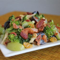 Spring Salad Recipe - Broccoli florets, crumbled bacon, red and green grapes, raisins, and slivered almonds are all tossed in a creamy dressing for a delicious broccoli salad.