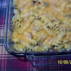 Creamy Chicken and Broccoli Casserole Recipe - A hearty combo of rotini pasta, ground chicken, and diced broccoli mixed in a creamy sauce, this kid-friendly main dish is topped with melted Cheddar cheese.