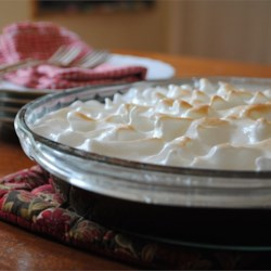 Margaret's Southern Chocolate Pie Recipe - This rich, creamy pie has a cooked filling that's like chocolate velvet. It's covered with meringue and baked until the tiny peaks of meringue are golden.