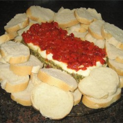 Pesto Torta (Layered Spread) Recipe - A super cream cheese and pesto spread. Very simple, but a great flavor combination.  It looks very pretty for Christmas parties. Serve with crackers or bread.