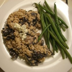 Gorgonzola and Wild Mushroom Risotto Recipe - This savory, well balanced risotto with dried chanterelles and Gorgonzola cheese works well as a main course.