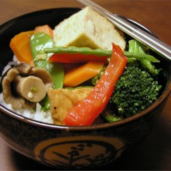 Ginger Veggie Stir-Fry Recipe - This recipe calls for broccoli, snow peas, carrots, and green beans, but you can use any of your favorites. The vegetables are stir fried with garlic, ginger, and soy sauce. Serve over your favorite rice.