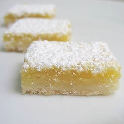 Lemon Squares I Recipe - Lemon squares are a perfect treat for a hot summer day. Use this recipe featuring walnuts and be the hit of the pool party.