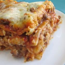 Easy Lasagna II Recipe - This lasagna recipe calls for uncooked noodles to be baked between layers of cheese and beef in spaghetti sauce.