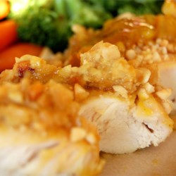 Cashew Crusted Chicken Recipe - Chicken breasts dipped in an apricot/mustard sauce, then rolled in chopped cashew nuts for a wonderfully tangy, crunchy and easy baked chicken dish. This recipe will satisfy anyone!
