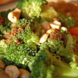 Broccoli with Garlic Butter and Cashews Recipe and Video - A new recipe a neighbor gave us. What a hit with my family. Just the right mixture of garlic and cashews with our favorite side dish, broccoli. And, so very easy to make!! If in a pinch, you could probably use frozen broccoli too, but I haven't tried.