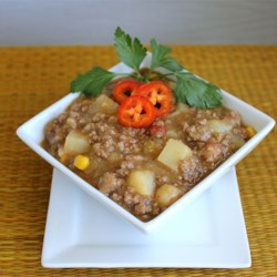 Easy Green Chile Stew Recipe - A quick and hearty Southwestern-inspired soup has plenty of ground beef, hominy, potatoes, and green chilies.