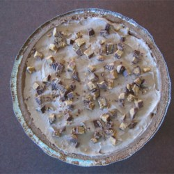 Chocolate Peanut Butter Pie II Recipe -  To make this guilt-free pie, reduced fat peanut butter, fat free chocolate pudding, and light whipped topping are mixed together and poured into a graham cracker crust and chilled.