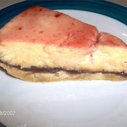 Peanut Butter and Jelly Cheesecake Recipe - As the name suggests, this is a peanut butter cheesecake with your favorite flavor of jelly on top.