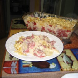 Grandma's Dried Beef Casserole Recipe - Egg noodles and dried beef mingle in a rich cheesy sauce in this casserole that is topped with crushed potato chips. This was my favorite meal when staying with Grandpa and Grandma. Hope you enjoy!