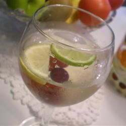 Winter White Sangria Recipe - Lemon, lime, apples, and grapes are added to white wine and brandy to create this refreshing twist on sangria.