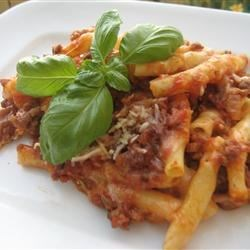 Baked Ziti IV Recipe - Ziti pasta is layered with Provolone, mozzarella, cottage cheese, sour cream and a meaty sauce with ground beef and sausage.