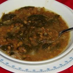 Adas bil Hamod (Lebanese Lentil Lemon Soup) Recipe - This Lebanese version of traditional lentil soup with spinach is seasoned with mint and lemon juice. It's traditionally served with toasted French bread for dipping.