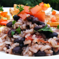 Quick Black Beans and Rice Recipe - This ones pretty straight forward. Brown rice, black beans, stewed tomatoes, a bit of onion and oil, and in about fifteen minutes you have a hearty, delicious meal. Serves four.
