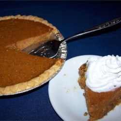 Praline Pumpkin Pie II Recipe - A pecan praline crust filled with a spiced pumpkin custard complements any holiday meal.