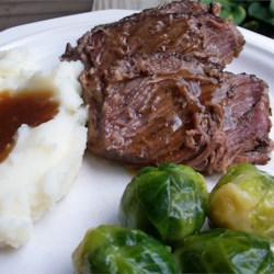 Slow Cooker Roast Beef Recipe and Video - Roast beef cooked very slowly for 22 hours in soy sauce and dry onion soup mix. Makes lots of juice that can be thickened to make an easy and delicious gravy.