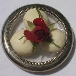 Rasgullas in Rose Syrup