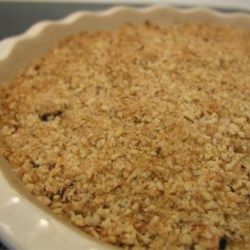 Apple Crisp Recipe - Apples baked with a brown sugar, butter and walnut topping.  A delicious desert, or a treat for breakfast!
