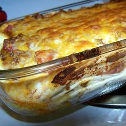 Smothered Mexican Lasagna Recipe - A layered casserole made with ground turkey, ricotta and flour tortillas.