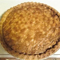 Southern Peanut Butter Pie Recipe - Yes, it is gloriously Southern -- as I am, and a family favorite! It's made with dark corn syrup, peanut butter and whole peanuts and looks like pumpkin pie, but don't be fooled!   This pie is simple and delicious for those who like peanut butter.  It is a great recipe to serve guests as it is an unexpected taste treat!