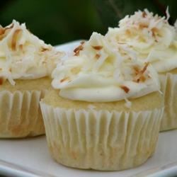 Coconut-Cream Cheese Frosting Recipe - Sweetened, shredded coconut adds flavor and texture to a luscious butter and cream cheese frosting that's easy to make and ever so good. Use toasted coconut as a garnish to create an extra elegant cake.