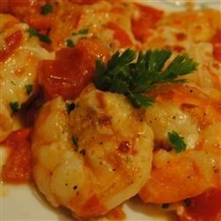 Shrimp Scampi and Tomato Broil Recipe - Sprinkle mozzarella cheese over classic shrimp scampi and broil until bubbly for a company-worthy entree that is a snap to prepare.