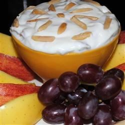 Almond Sour Cream Dip Recipe - I got this recipe from a former co-worker.  It is the best dip for fresh fruit I have ever tasted. Slivered almonds are blended into a sweet, thick mixture of pure, creamy goodness.
