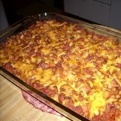 Johnny Marzetti IV Recipe - A savory blend of ground beef, onion, mushrooms, garlic, pepper, sugar and Worcestershire is simmered with tomato sauce and layered with noodles and sharp Cheddar cheese to make a zesty baked casserole.