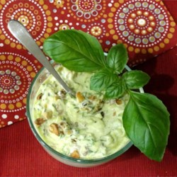 Zucchini Salad with Yogurt and Walnuts Recipe - This simple salad combines cooked, grated zucchini with yogurt and walnuts.