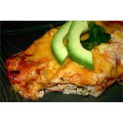 Savory Halibut Enchiladas Recipe - The filling for these enchiladas combines halibut with green onion, bell pepper, cilantro, sour cream, mayonnaise, and Cheddar cheese.