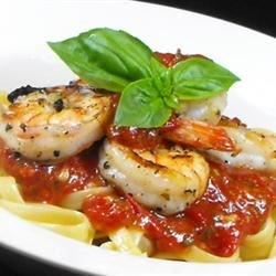 Fra Diavolo Sauce With Pasta Recipe - A daring dash of red pepper flakes gives off a spicy heat in this marvelous tomato garlic sauce with shrimp and scallops. Stir in a bit of parsley and serve over hot linguine.