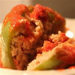 Vegetarian Stuffed Peppers Recipe - This was the first vegetarian recipe I ever made--green peppers stuffed with a mixture of brown rice, nuts, dried cranberries, tofu and cheese.  Substitute soy cheese for the Parmesan to create a vegan delight.