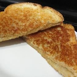 Grilled Cheese and Peanut Butter Sandwich Recipe - Just what the name suggests.  Melted cheese and sweet, gooey peanut butter is a delicious combo!