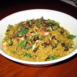 Easy Curry Couscous Recipe - This recipe is a perfect accompaniment to lamb chops or any grilled seafood. It's light and refreshing and very easy to make!