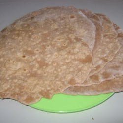 Whole Wheat Wraps Recipe - These are great!  Make your favorite Mexican dish, or alternate sandwiches or even cut these in wedges and fry for whole wheat tortilla chips! You may omit the baking powder if you wish.
