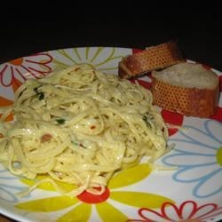 Creamy Linguini for Two Recipe - A very quick and delicious pasta dish with a light, creamy blend of Parmesan cheese and ground nutmeg.  Serve with a tossed green salad and some garlic bread.