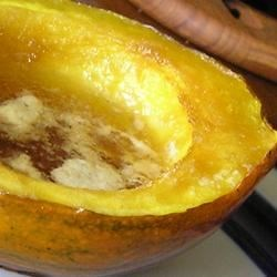 Baked Acorn Squash Recipe - In this simple recipe, acorn squash are baked and then seasoned with salt and pepper, and sweetened with brown sugar, cinnamon and butter.