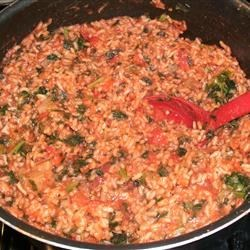Tomato Rice Stew Recipe - This thick, rich blend of rice, spinach, potatoes, and tomatoes makes a filling, delicious meal.