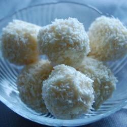 Snowflake Truffles Recipe - Whole almonds are surrounded by a ricotta cheese and coconut mixture and coated with white chocolate to make 'snowballs' you can enjoy any time of year.