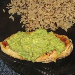 Spicy Avocado Chicken Recipe and Video - A simple sauce of onion, avocado, and lime juice is served over pan-fried chicken breasts for a spicy main course.