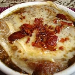 Julia's Excellent French Onion Soup Recipe - The onions for this soup are sauteed in bacon fat which provides extra flavor and richness.  White wine and sherry are added during cooking and the individual bowls of soup are topped with Gruyere toasts and placed under the broiler until the cheese is ho