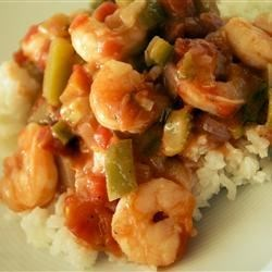 Shrimp Etouffee II Recipe - This is a very easy shrimp etouffe recipe that utilizes your microwave! I usually add four dashes of hot pepper sauce to the dish, but bring the hot stuff to the table in case someone wants a zestier dinner! This recipe is one I learned while going to school in southern Louisiana - Geaux Tigers!